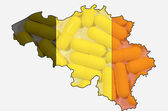 Outline map of Belgium with transparent pills in background and — Stock Photo