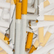 Outline map of Portugal with transparent cigarettes in backgroun - Stock Photo
