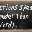 "Stock Photo: ""Actions speak louder thwords"" written on blackboard"