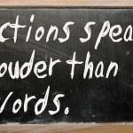 """""""Actions speak louder than words"""" written on a blackboard — Stock Photo"""