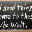 """All good things come to those who wait"" written on a blackboard — Stock Photo"