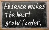 """Absence makes the heart grow fonder"" written on a blackboard — Stock Photo"