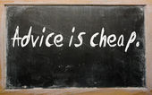 """""""Advice is cheap"""" written on a blackboard — Stock Photo"""