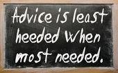 """""""Advice is least heeded when most needed"""" written on a blackboar — Stock Photo"""