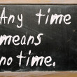 """""""Any time means no time"""" written on a blackboard — Stock Photo"""