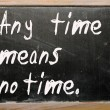 "Stok fotoğraf: ""Any time means no time"" written on blackboard"