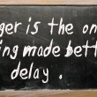 """Anger is the one thing made better by delay"" written on a black — Stok fotoğraf"