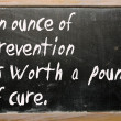 """An ounce of prevention is worth a pound of cure"" written on a b — Stock Photo"