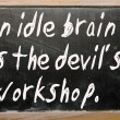 "Stock Photo: ""idle brain is devil's workshop"" written on blackbo"