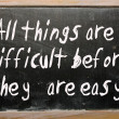 "Stock Photo: ""All things are difficult before they are easy"" written on bla"