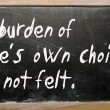 "Stockfoto: ""burden of one's own choice is not felt"" written on blac"