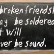 "Stockfoto: ""broken friendship may be soldered but will"" written on blac"