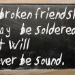 "Photo: ""broken friendship may be soldered but will"" written on blac"