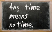 """Any time means no time"" written on a blackboard — Photo"