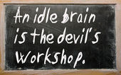 """""""An idle brain is the devil's workshop"""" written on a blackbo — Stock Photo"""