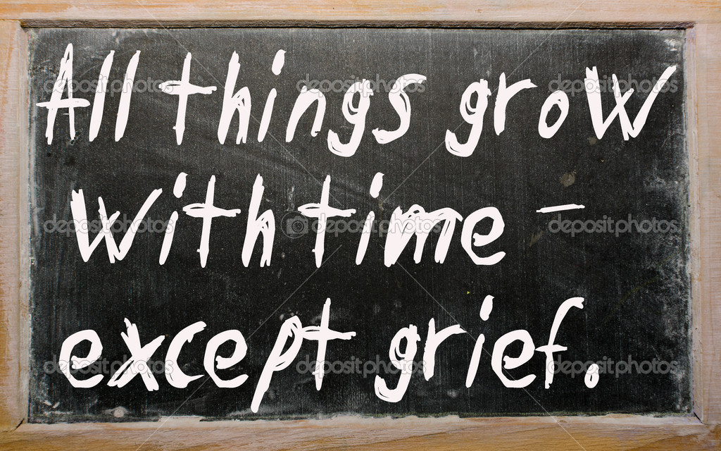Blackboard writings All things grow with time - except grief — Stock Photo #6642511