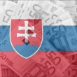 Stock Photo: Flag of Slovakia with transparent euro banknotes in background