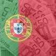 Stock Photo: Flag of Portugal with transparent euro banknotes in background
