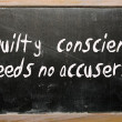 """A guilty conscience needs no accuser"" written on a blackboard — Stock Photo"