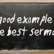 """A good example is the best sermon"" written on a blackboard — Stock Photo"