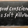 Royalty-Free Stock Photo: A good conscience is a soft pillow written on a blackboard