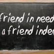 """friend in need is friend indeed"" written on blackboard — Stockfoto #6692741"