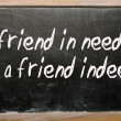 """friend in need is friend indeed"" written on blackboard — Stock Photo #6692741"