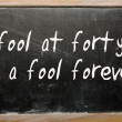 """A fool at forty is a fool forever"" written on a blackboard — Stok fotoğraf"