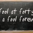 "Foto Stock: ""fool at forty is fool forever"" written on blackboard"