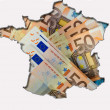 Outline map of France with euro banknotes in background — Stock Photo