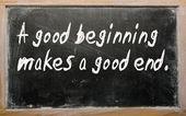 """""""A good beginning makes a good end"""" written on a blackboard — Stock Photo"""