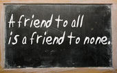"""A friend to all is a friend to none"" written on a blackboard — Stock Photo"
