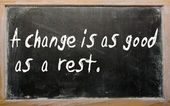 """A change is as good as a rest"" written on a blackboard — Stock Photo"