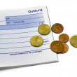 Receipt with euro coins and ball-pen — Stock Photo