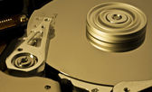 Hard disk drive with moving head and spinning platter -aaa- — Stock Photo