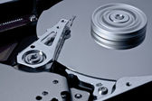 Hard disk with rotating platter — Stock Photo
