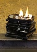Burning stack of hard drives — Stock Photo