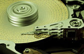 Hard disk drive with yellow data — Stock Photo