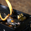 Flames on open hard drive - Stock Photo