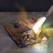 Melting down a copper cooling element - Stock Photo