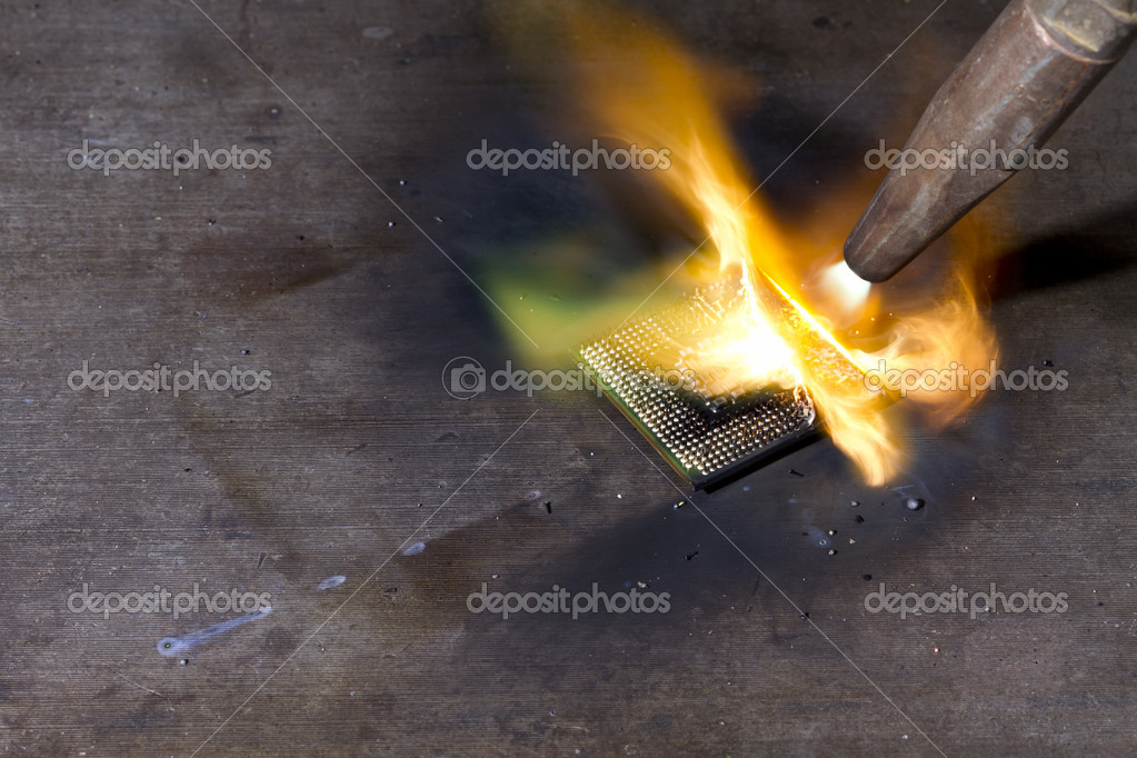 Burning cpu with blow pipe.  Stock Photo #6490498