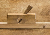 Planer on wood in brown background — Stock Photo