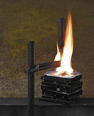 Flames on stack of pressed hard drives — ストック写真