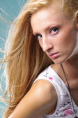 Young woman with beautiful long blond hair — Stock Photo
