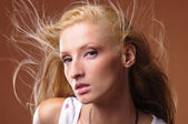 Young woman with beautiful long blond hair in the wind — Stock Photo