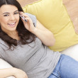 Happy Hispanic Woman Using Cell Phone At Home — Stock Photo