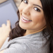 Happy Hispanic Woman Using Tablet Computer or iPad — Stock Photo