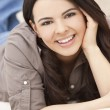 Beautiful Hispanic Woman Laying on Sofa Relaxing & Smiling — Stock Photo