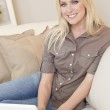 Young Blond Woman Using Laptop Computer At Home on Sofa — Stock Photo