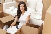 Single Woman Unpacking Boxes Moving House — Stock Photo